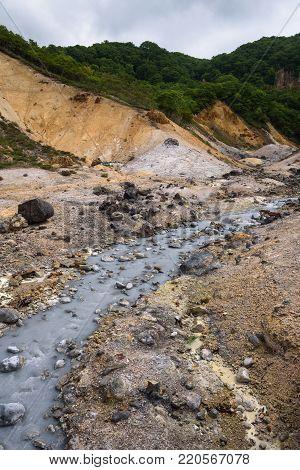 Small river streams through the rocks of Hell Valley (Jigokudani), Noboribetsu, Hokkaido, Japan