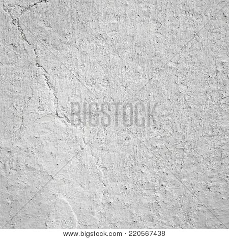 Whitewashed plastered wall, textured background. Space for text