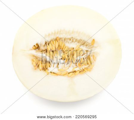 One melon (Piel de Sapo, Honeydew) half with seeds top view isolated on white background