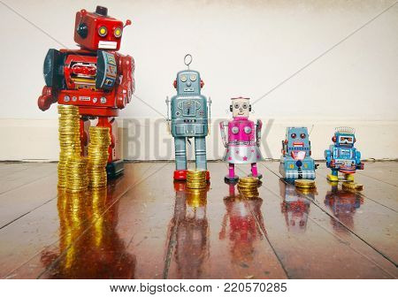 A line of retro toys with staks of gold coines on a wooden floor concept equality