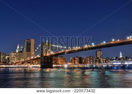 HDR view of a Brooklyn Bridge at night taken from Brooklyn Bridge Park.