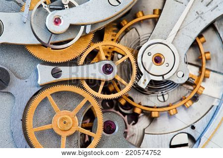 Clock transmission macro view. Stopwatch chronometer mechanism cogs gears wheels connection concept. Shallow depth of field, selective focus