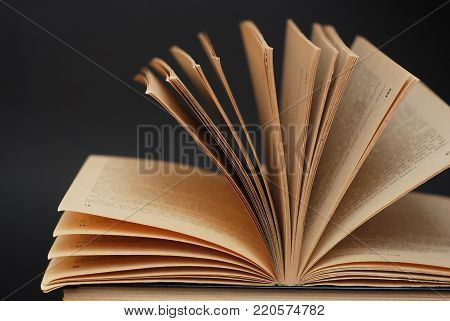 Open Book on a Black Background. Isolated.
