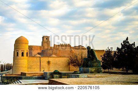 Exterior view to Ota-Darvoza gate and Statue of Muhammad ibn Musa al-Khwarizmi at Khiva, Uzbekistan