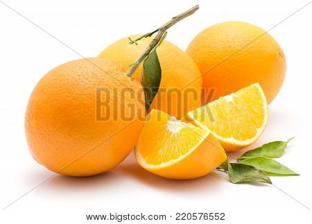 Oranges isolated on white background three whole two sliced quarters green leaves