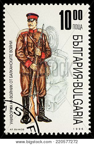 Moscow, Russia - January 02, 2018: A stamp printed in Bulgaria, shows uniform of soldier Balkan War, series