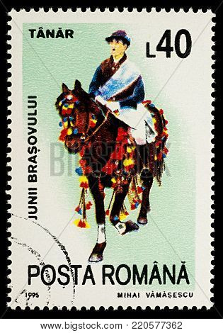 Moscow, Russia - January 03, 2018: A stamp printed in Romania, shows celebrating man riding on a decorated horse, Tanar, series