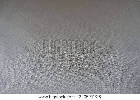 Closeup of simple unprinted beige jersey fabric