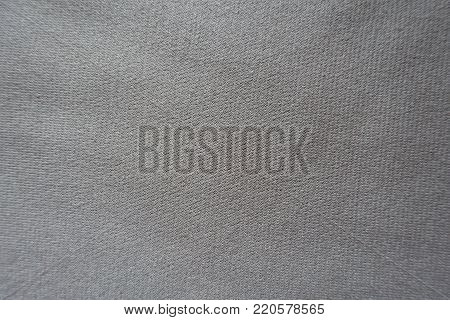 Simple unprinted beige jersey fabric from above