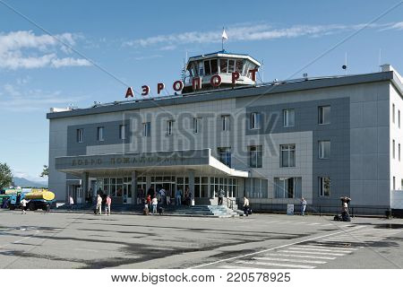 PETROPAVLOVSK, KAMCHATKA PENINSULA, RUSSIA - AUGUST 14, 2011: Summer view of building of airport terminal Petropavlovsk-Kamchatsky, station square; in good weather, a clear sunny day with a blue sky.