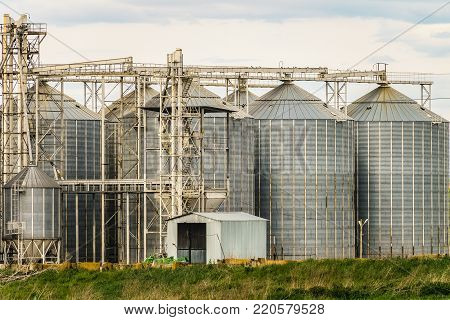 Agricultural grain dryer complex close-up. Modern granary with weighing station.