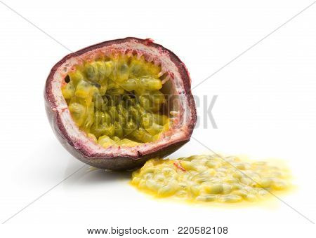 One passion fruit half with juicy flesh isolated on white background
