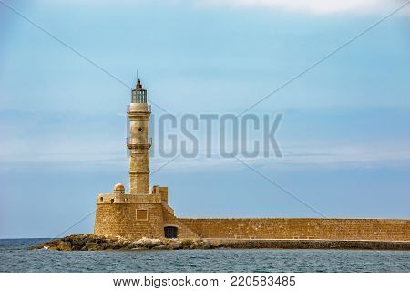 Old medieval lighthouse in port of Chania on Crete island. Greece