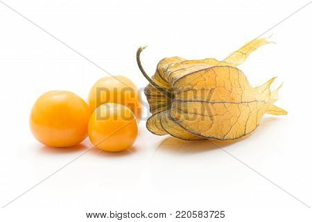 Physalis stack isolated on white background three orange berries and one in husk