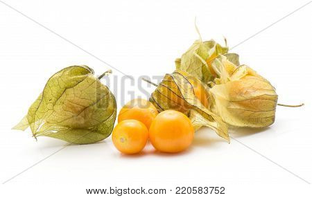 Physalis stack isolated on white background three orange berries and a lot of in husk