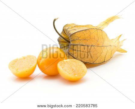 Physalis stack isolated on white background one in husk one orange berry and two halves