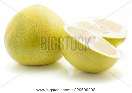 Sliced pamelo isolated on white background one whole pale green yellow and two halves poster