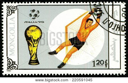Ukraine - circa 2018: A postage stamp printed in Mongolia shows drawing Soccer goalkeeper. Trophy and soccer play. Italia 90. Series: World Cup Football. Circa 1990.