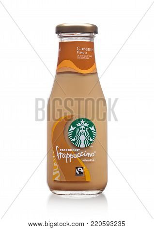 London, Uk -december 07, 2017: Glass Bottle Of Starbucks Frappuccino Coffee Drink With Caramel On Wh