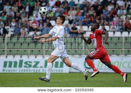 KAPOSVAR, HUNGARY - MAY 14: Istvan Bank (in white) in action at a Hungarian National Championship soccer game - Kaposvar vs Szolnok on May 14, 2011 in Kaposvar, Hungary.
