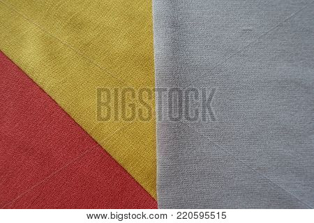 Orange, yellow and beige fabrics sewn together
