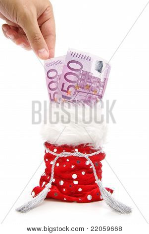 A Hand Taking Money Bills From Gift Bag