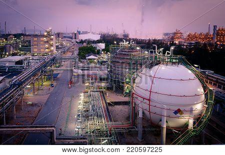 Gas storage sphere tanks in oil refinery industry plant, Glitter lighting of petroleum industrial