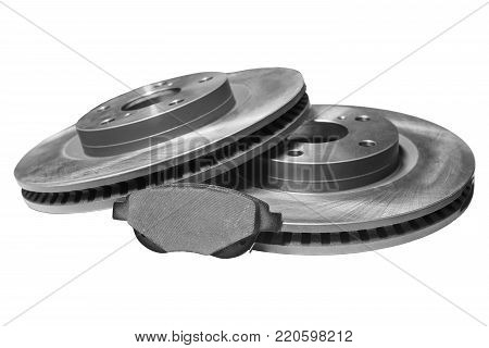 brake pad and discs with shallow depth of field on a white background