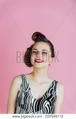 pinup, youth and look. Girl in stylish vintage dress on pink background. Beauty and fashion, cosmetics. Makeup, hairdresser and cosmetics. Woman with retro hair and fashionable makeup, pinup.