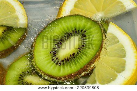 bio kiwi fruit floating on the water surface