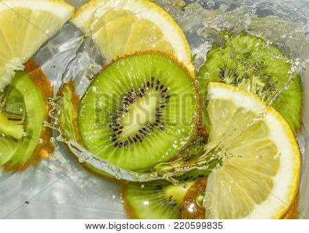 bio kiwi fruit floating on the water surface poster