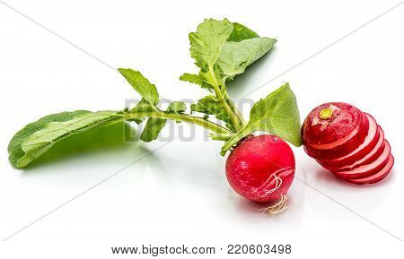 One bulb of red radish with leaves, sliced round circles, isolated on white background