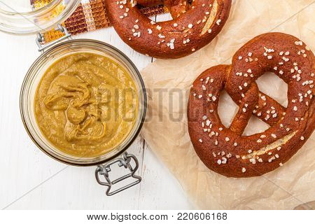 Freshly baked homemade soft pretzels. A few salty pretzels with mustard