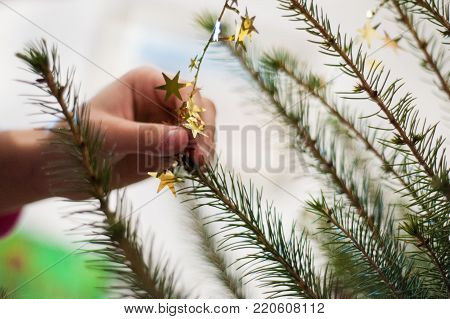 hand adorn Christmas tree decoration of gold color