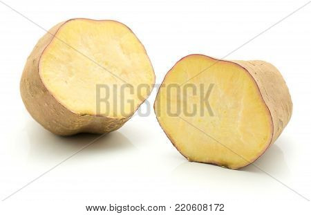 Sliced sweet potato isolated on white background one cut in two halves