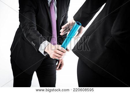 Studio shot of business people passing relay baton