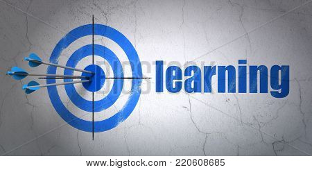 Success Studying concept: arrows hitting the center of target, Blue Learning on wall background, 3D rendering