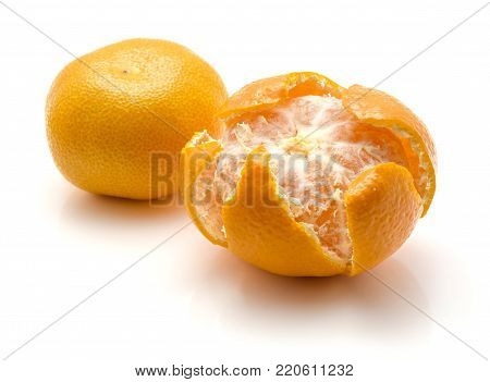 Two tangerines isolated on white background one whole one open