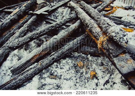 charred embers, covered with hoarfrost lie on the snow