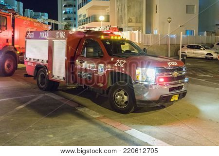 Nahariyya, Israel, November 30, 2017 : Red fire truck is standing on a city street in Nahariyya city in Israel