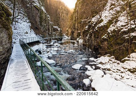 Snowy landscape with part of the ecotrail in Devinska River gorge in Bulgaria