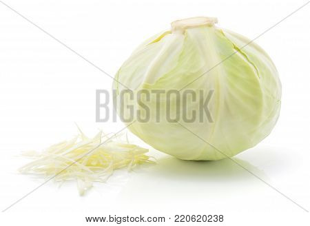Chopped white cabbage and one whole head isolated on white background