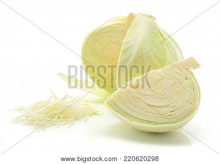 Chopped white cabbage and one cut open head with a quarter isolated on white background