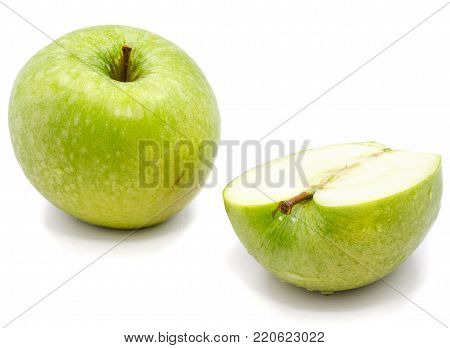 One whole apple Granny Smith and a half isolated on white background