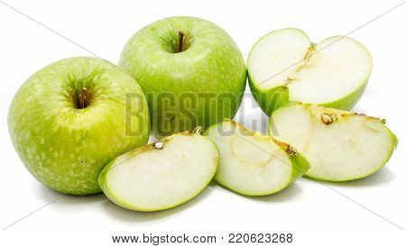 Two whole apples Granny Smith, three slices and one half, isolated on white background
