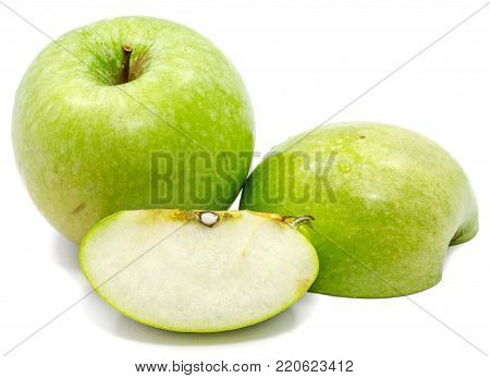 Granny Smith apples, one whole, sliced and half, isolated on white background