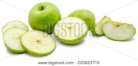 Sliced Granny Smith apples, one whole apple, circles and slices, isolated on white background