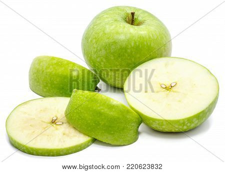Sliced Granny Smith, one whole apple, circles and slices, isolated on white background