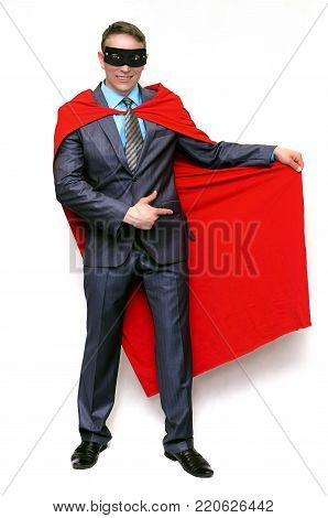 Super hero man showing by index finger on copy space on his red cloak isolated on white background.