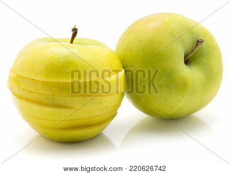 Sliced apple (Smeralda variety) isolated on white background one whole and one sliced comparing